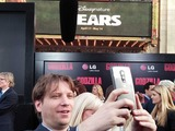 Godzilla director, Gareth Edwards, snaps a selfie at the film's red carpet premiere with the new LG G Flex