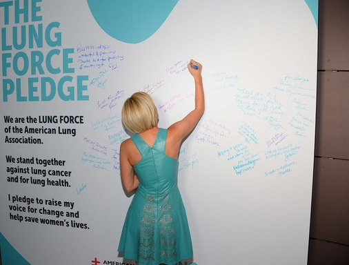 Kellie Pickler signs LUNG FORCE pledge wall at the American Lung Association's national kickoff reception in New York City.