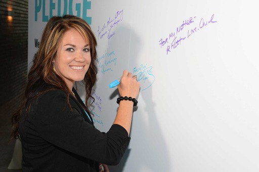 Mackena Bell signs the LUNG FORCE pledge wall at the American Lung Association's LUNG FORCE national kickoff reception in New York City.