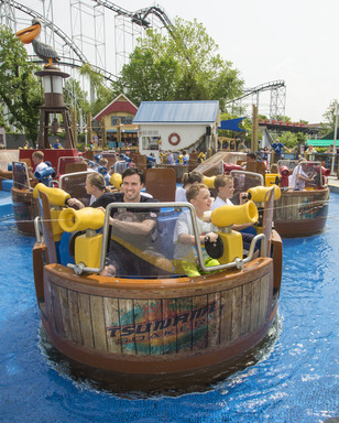 Olympic swimmer and Gold Medalist Davis Tarwater joins local swimteam on the new Tsunami Soaker at Six Flags St. Louis. While the ride spins and turns, guests soak each other with giant water cannons.