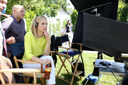 Actress Kristen Bell watches behind the camera on the set of a mini film series for Lipton Iced Tea that supports its 'Win an Extra SUNday' promotion where Bell served in her first creative director role. Watch videos at BeMoreTea.Tumblr.com.