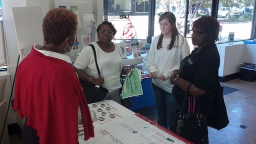 A Cities for Life representative talks with Birmingham community members about the program and about the importance of addressing diabetes.
