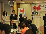 Fei Changhui, county magistrate of Wuyuan, giving speeches at promotional events held in South Korea