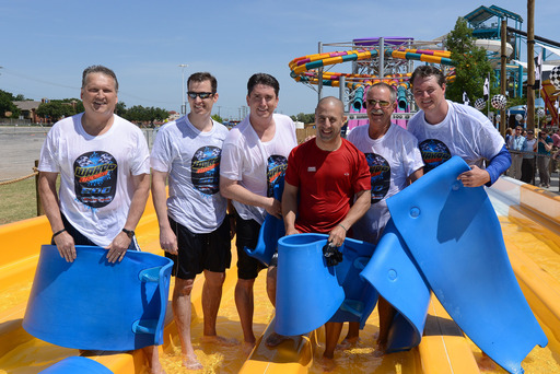 Indy 500 racing champ, Tony Kanaan, participated in the Wahoo Racer 500 versus several Arlington city officials and Hurricane Harbor Park President, Steve Martindale, to help open up Wahoo Racer.