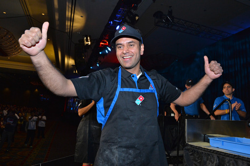 Pali Grewal wins the 2014 Domino's World's Fastest Pizza Maker Competition.