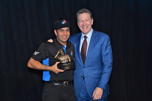 Pali Grewal, Domino's World's Fastest Pizza Maker celebrates a victory with Domino's President & CEO Patrick Doyle