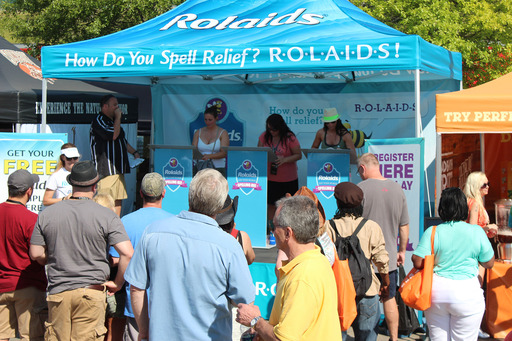 "Crowd gathers to watch contestants participate in a Rolaids ""Eat Your Words"" Spelling Bee event."