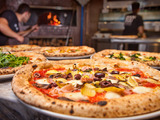 With a large assortment of toppings to choose from, 800 Degrees Neapolitan Pizzeria provides guests the opportunity to craft their perfect pie before it's baked in an 800-degree wood-burning oven.