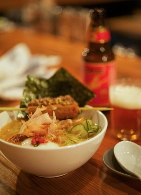 Yusho's Logan Poser Ramen features a hearty broth elevated by hen egg, nori and cucumber. An indulgent piece of crispy fried pork rests atop the unforgettable, signature dish.