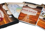The Open Road Gift Set includes The Open Road retrospective of the American Road Trip, a Rand McNally Mid-sized Road Atlas, a decorative Wall Map, and gift box.