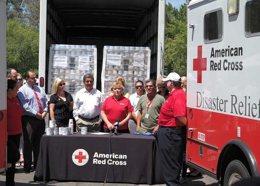 World Grocer donates Canned Emergency drinking water to  Red Cross