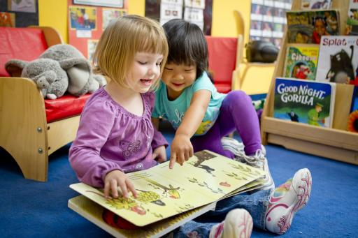 Young children have fun reading together