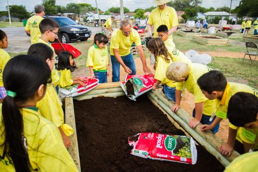 Children learn to garden at GR01000 event.