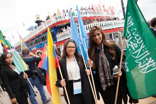 One Young World Delegates Hold Flags