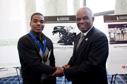 HS Grad Tyrell McGruder with Rep. Scott
