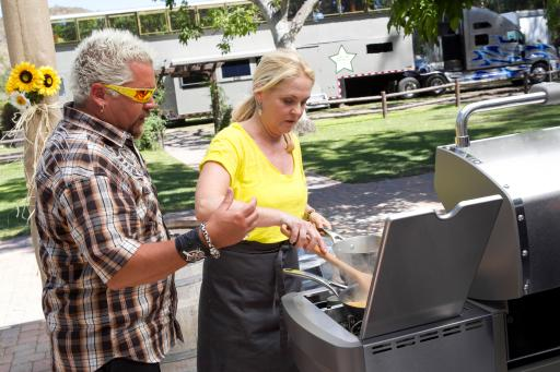 Guy Fieri and Cornelia Guest on Food Network's Rachael vs. Guy Celebrity Cook-Off