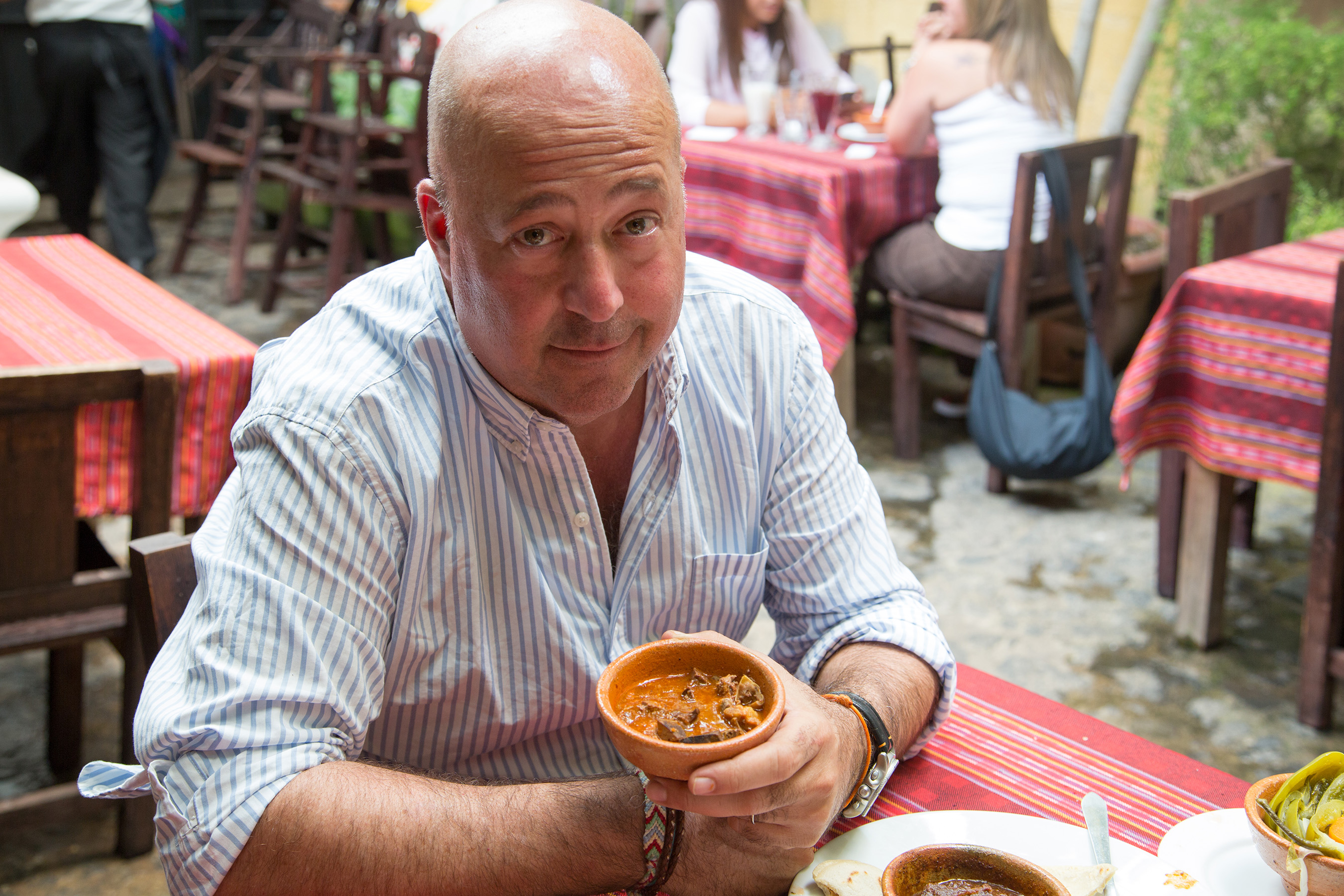 Host Andrew Zimmern presents the famous Guatemalan pig head stew, Revolcado, at restaurant La Cuevita de los Urquiz in Antigua.