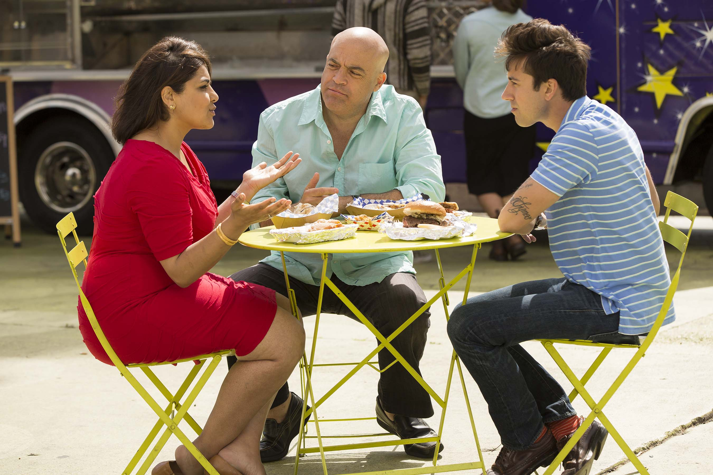 Judges Alpana Singh, Steak Shapiro and Andrew Gruel deliberate on Food Network's Food Truck Face Off