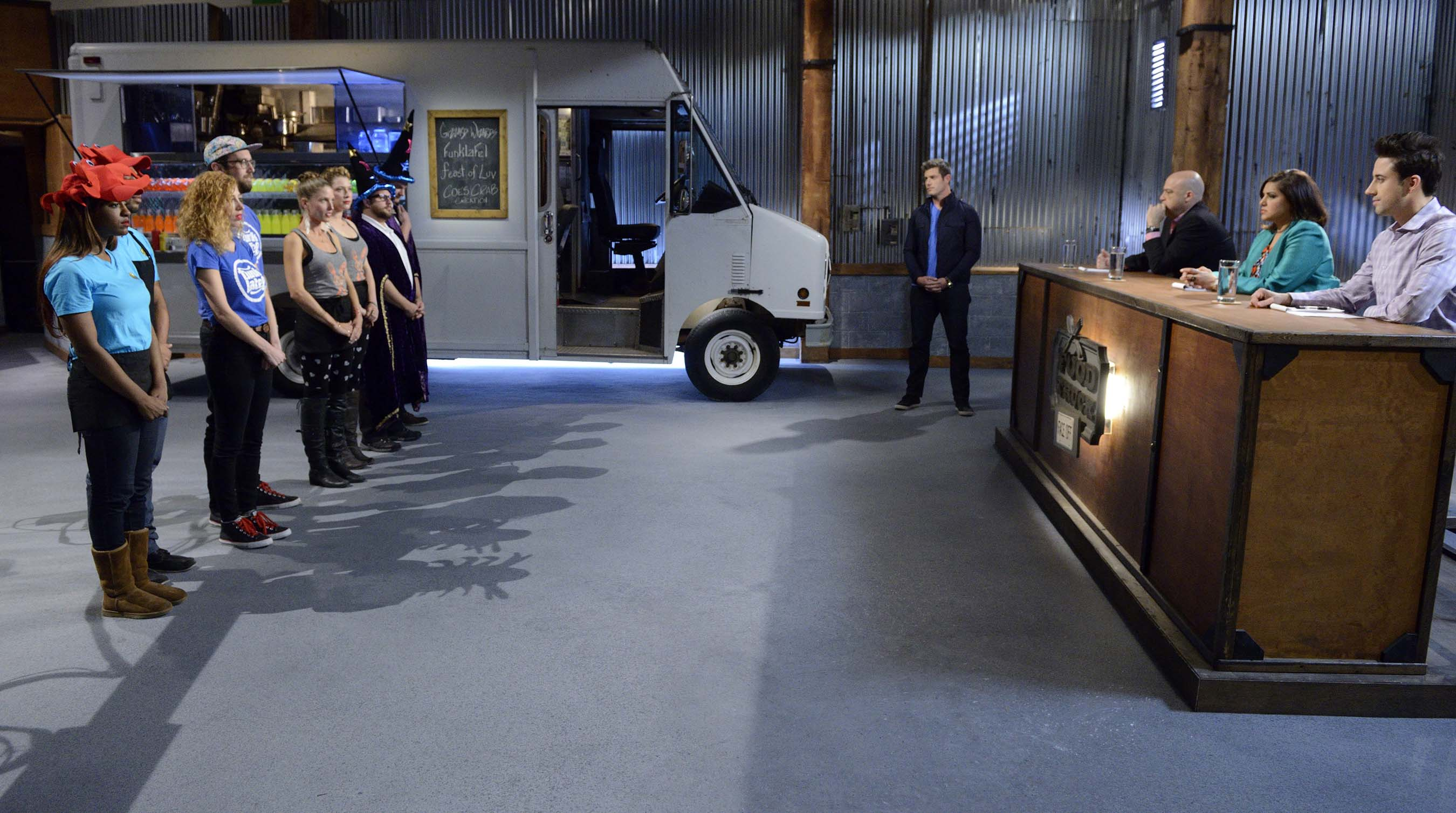 Contestants face the judges on Food Network's Food Truck Face Off