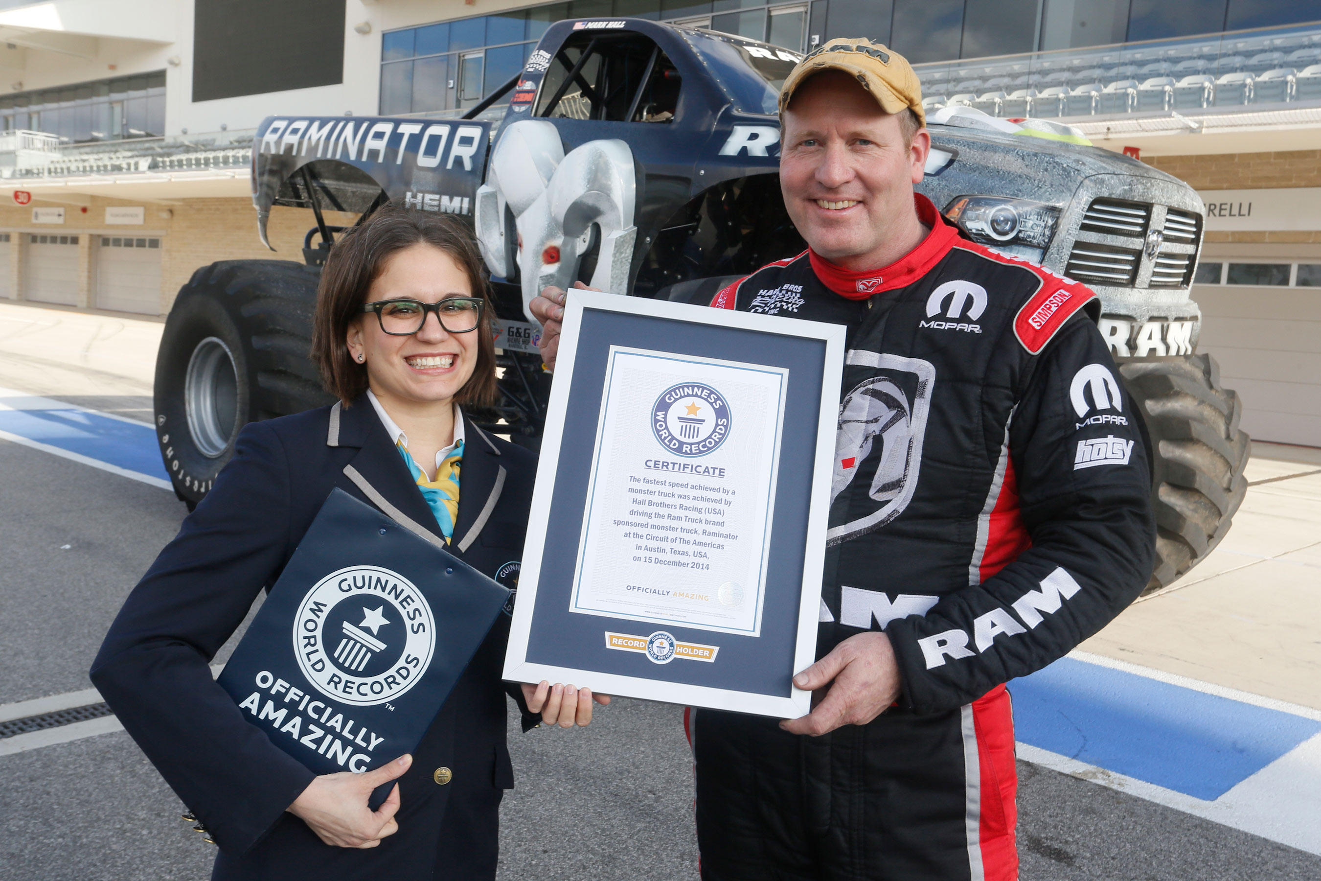 Guinness world records title holder for fastest speed for a monster truck raminator with driver mark hall and guinness representative johanna maria