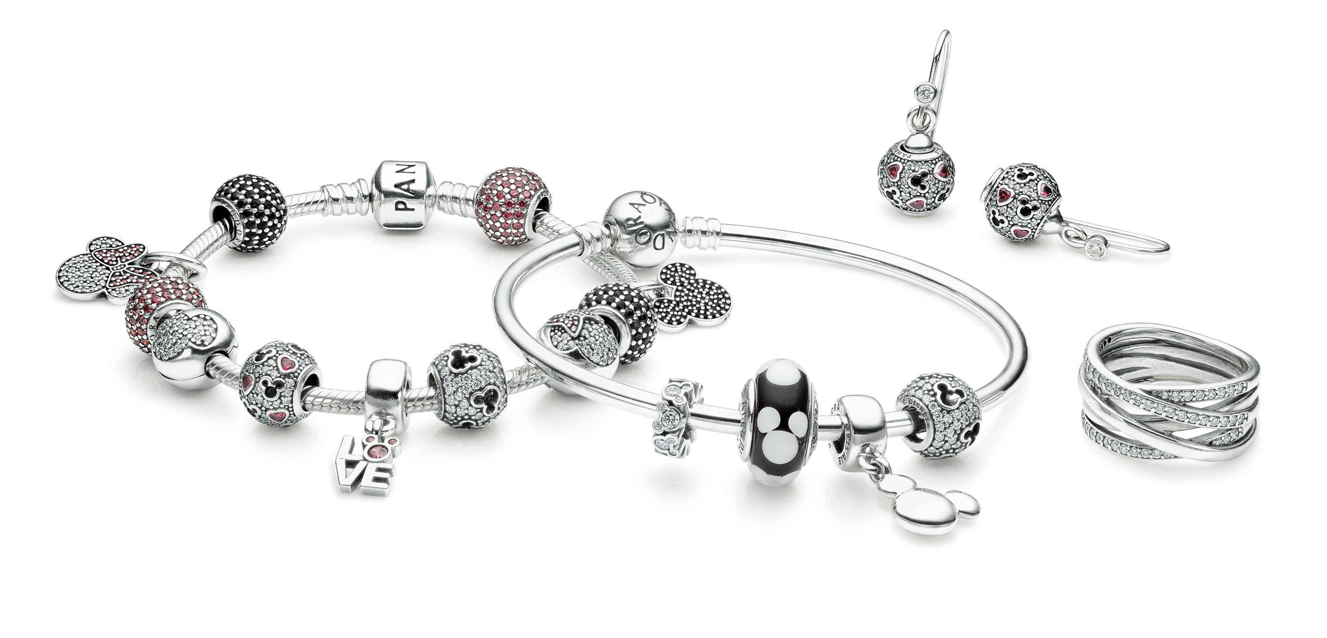 PANDORA's Disney jewelry collection of charms. Disney's animations are all grown up when charms are combined with other pieces from PANDORA's collection, such as sterling silver charm bracelets and bangles, stackable rings or earrings.