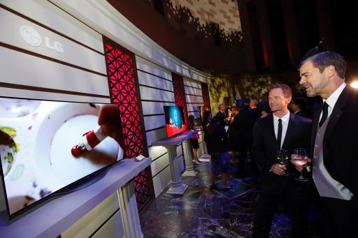LG Art of the Pixel ambassador Neil Patrick Harris checks out art with LG's Dave Vanderwaal in NYC