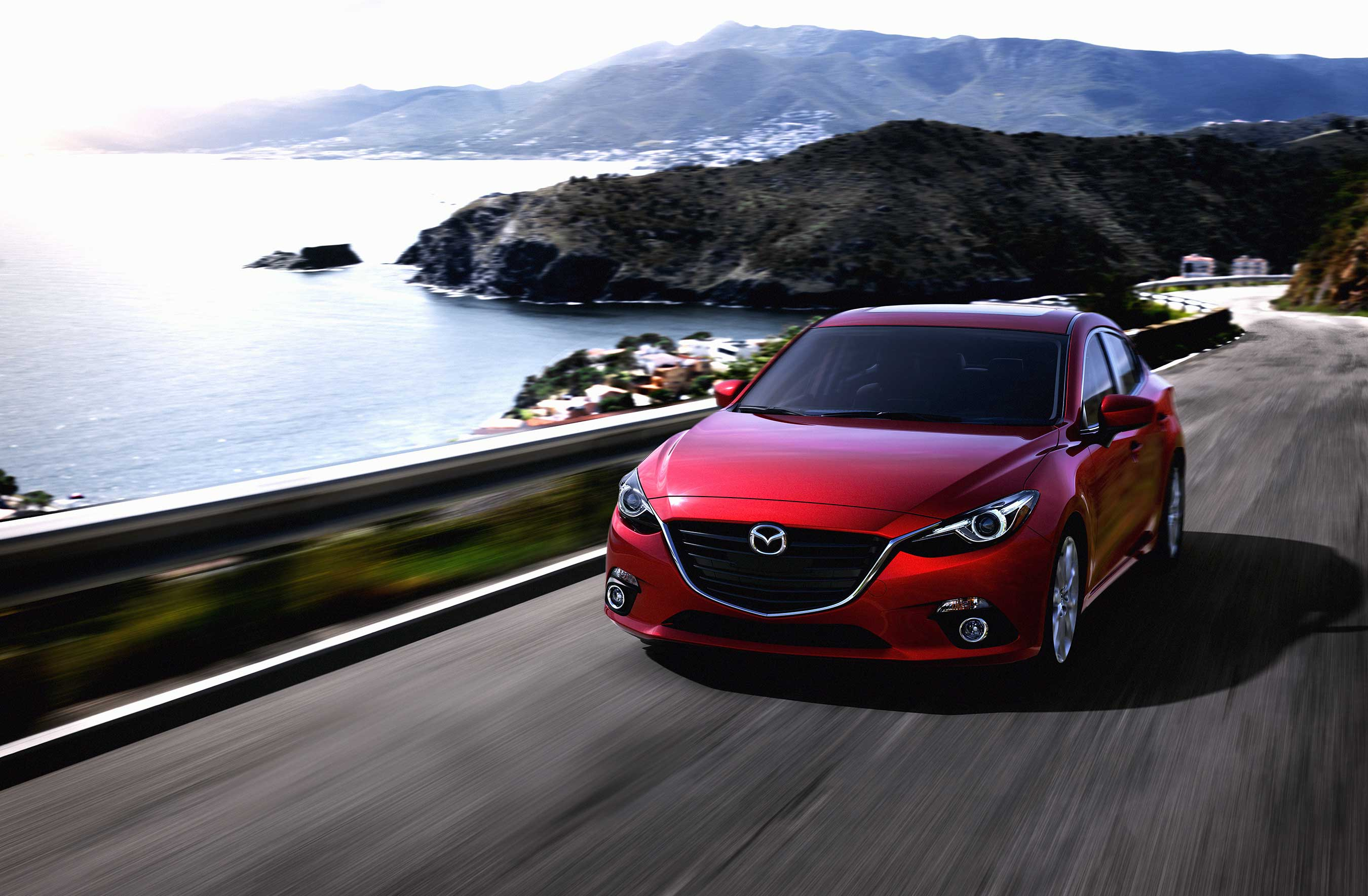 2014 MAZDA3: Since the beginning of its 11 year existence, the Mazda3 has been named one of Kelley Blue Book's Coolest New Cars Under $18,000.