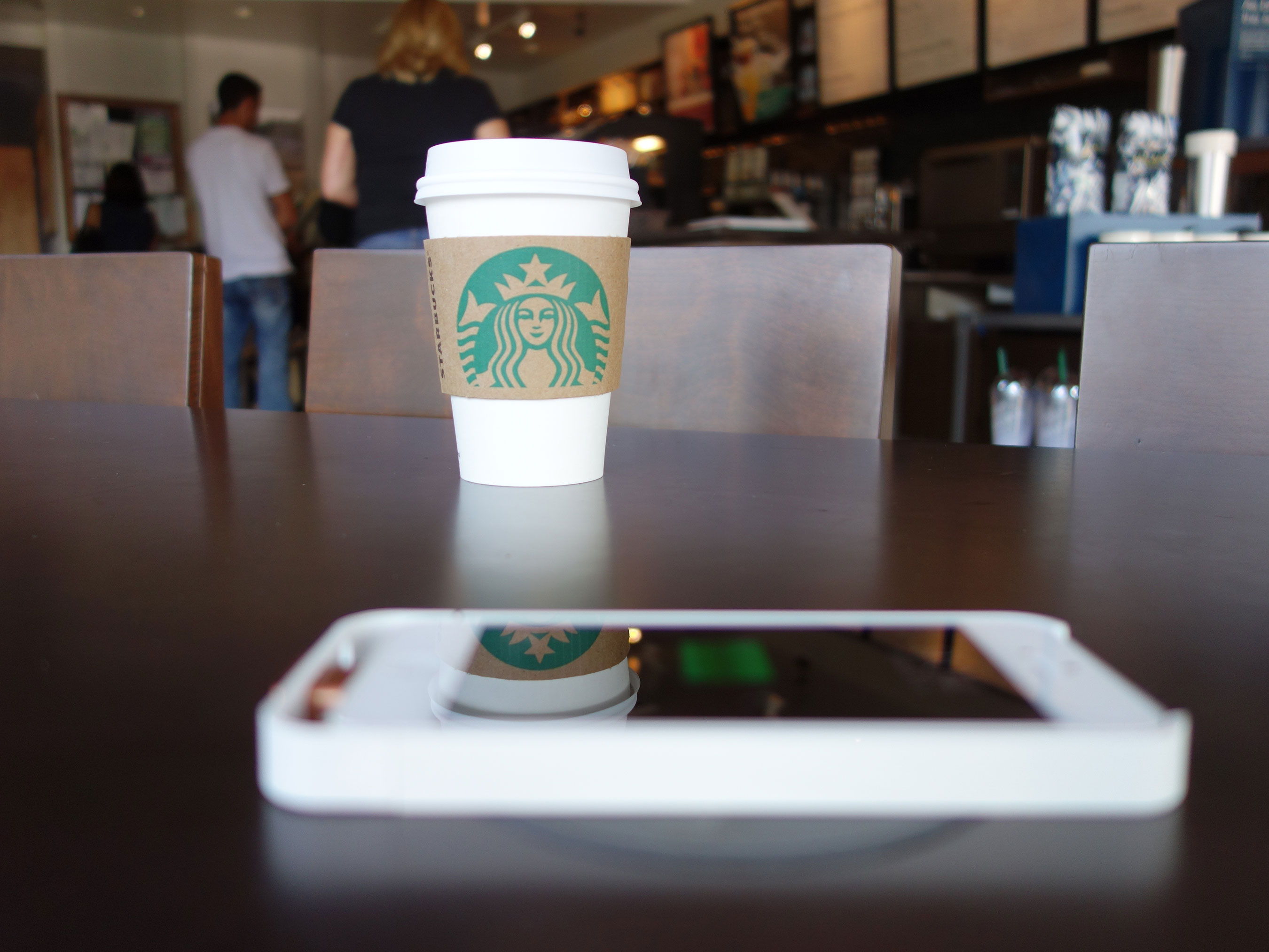 Phone with charger on Powermat at Starbucks