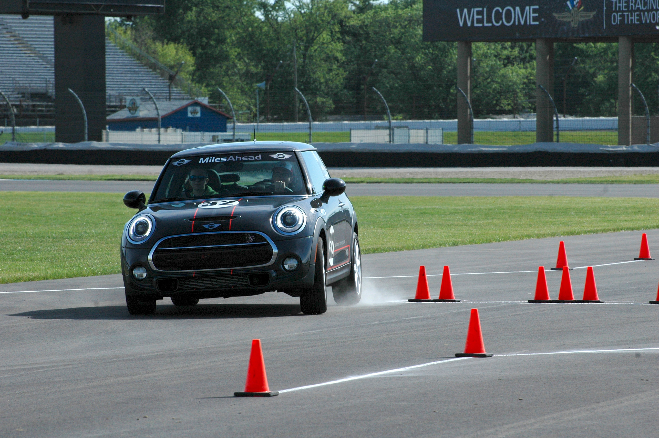 A MINI Hardtop takes tight turns around cones as part of the MINI Teen Motoring School.