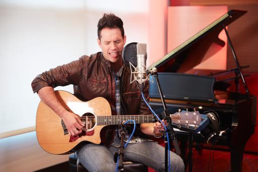Photo Caption: David Osmond, music artist, producer, MS advocate playing guitar