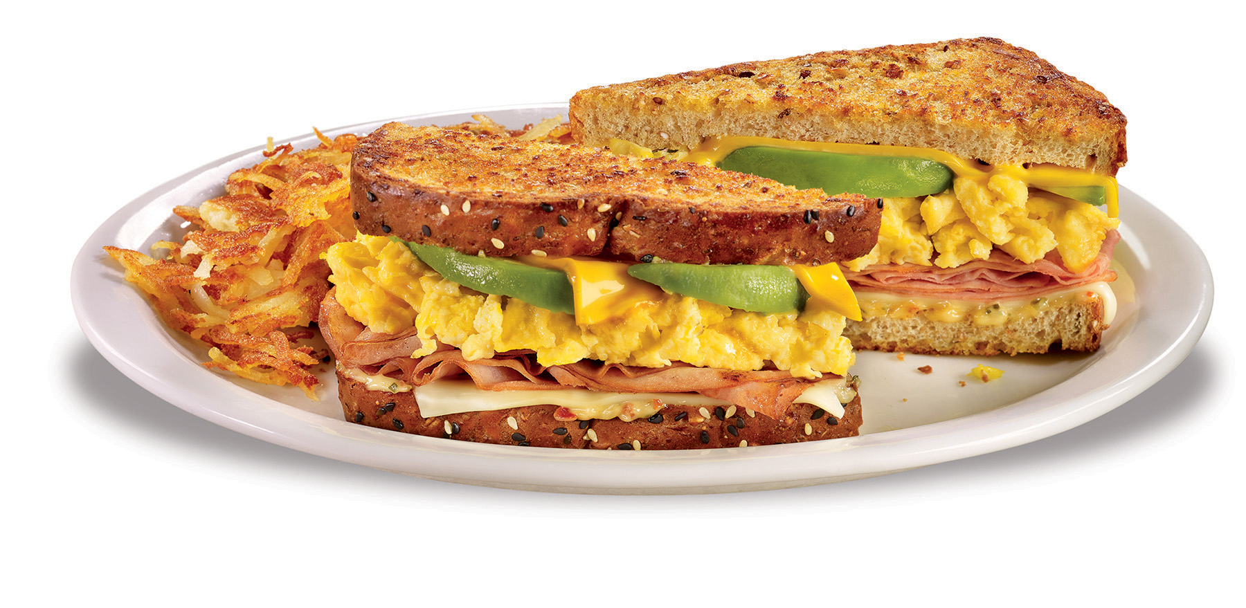 This celebrated sandwich has been given a fresh, new look with ham and scrambled egg topped with Swiss and American cheeses, sliced fresh avocado and sun-dried tomato mayo on grilled seven-grain bread