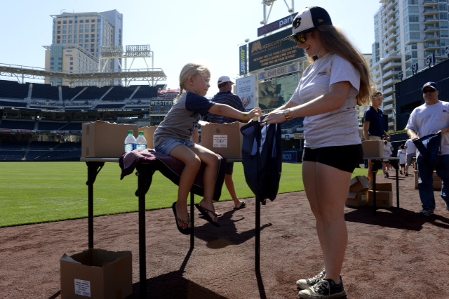 Mercury Insurance and the San Diego Padres kick-off the Fourth of July celebration with a salute to U.S. troops stationed in Afghanistan by assembling 1,000 care packages at Petco Park.