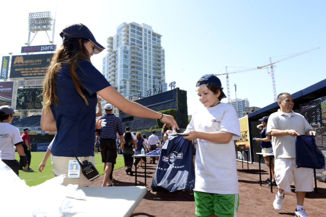 Mercury Insurance employees and agents, local little leaguers and San Diego Padres pitcher Ian Kennedy along with community representatives stuffed 1,000 care packages for U.S. troops at Petco Park.