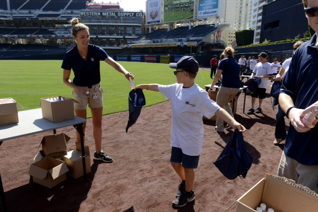 Mercury Insurance and the San Diego Padres start Independence Day weekend celebration with a salute to U.S. troops stationed in Afghanistan by assembling 1,000 care packages at Petco Park.