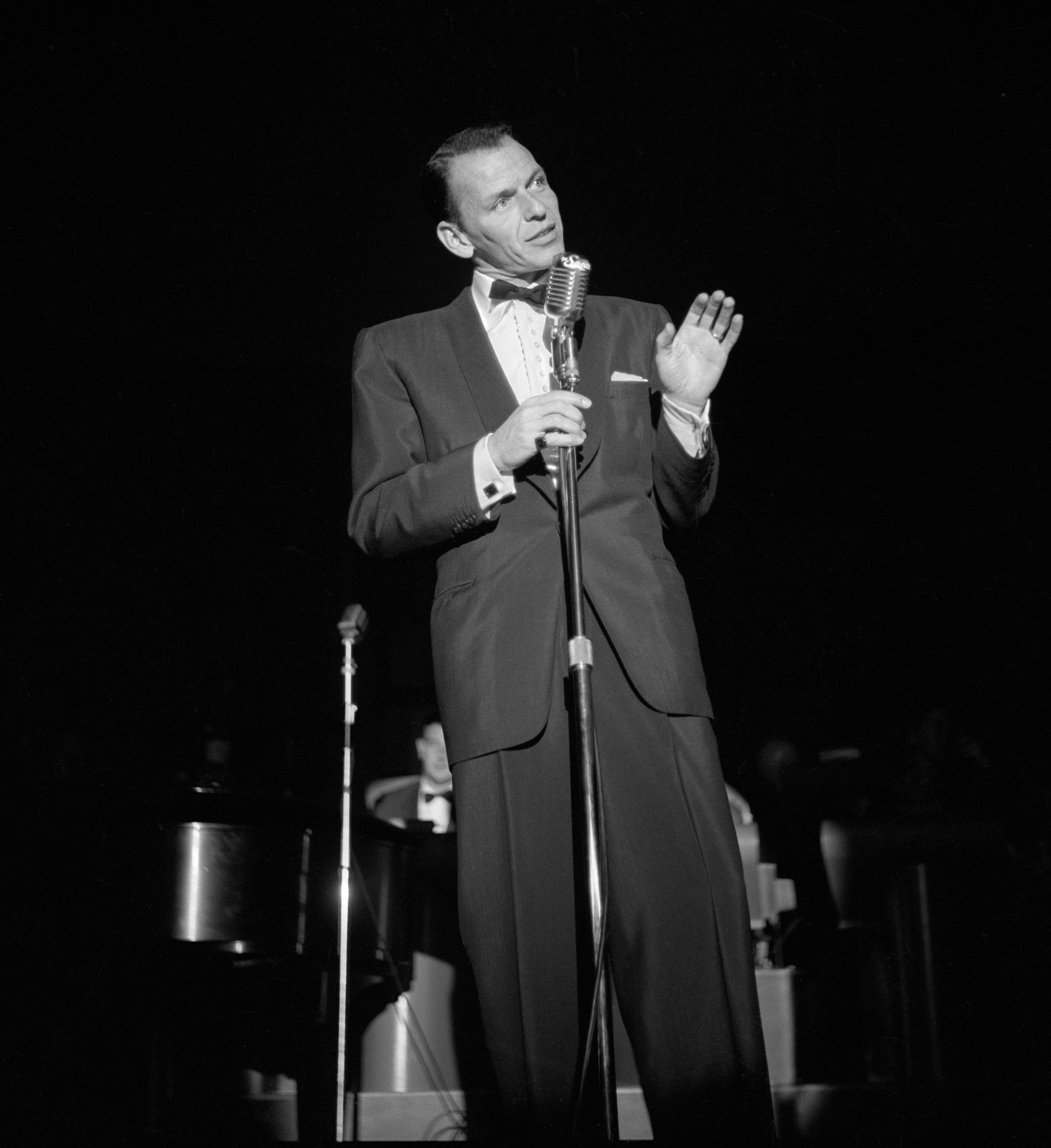 Frank Sinatra performs onstage at the Sands in Las Vegas in 1953.  CREDIT: Las Vegas News Bureau. For editorial use by news organizations only.