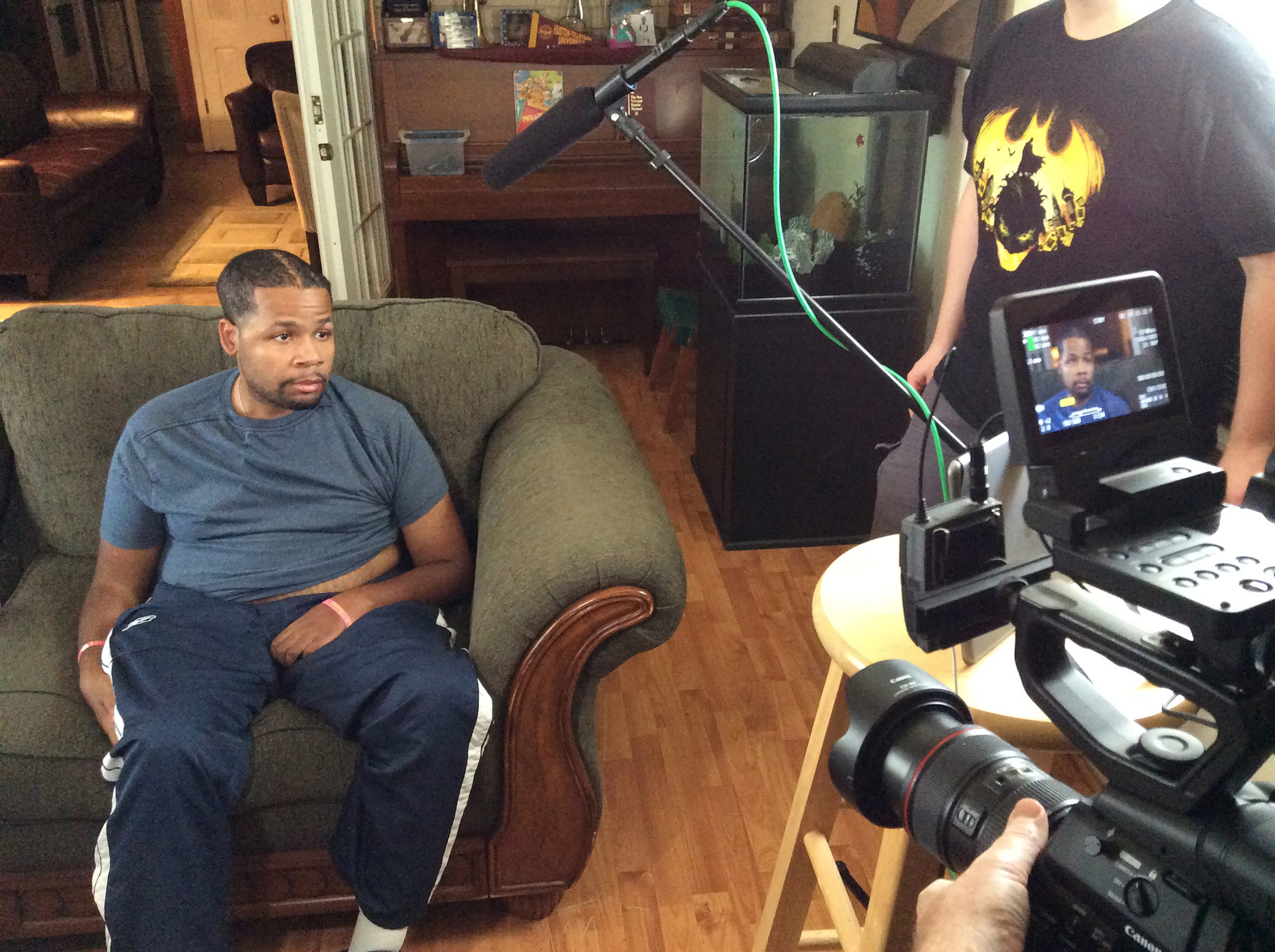 The film crew chats with Kirk J., a young stroke victim currently coping with PBA