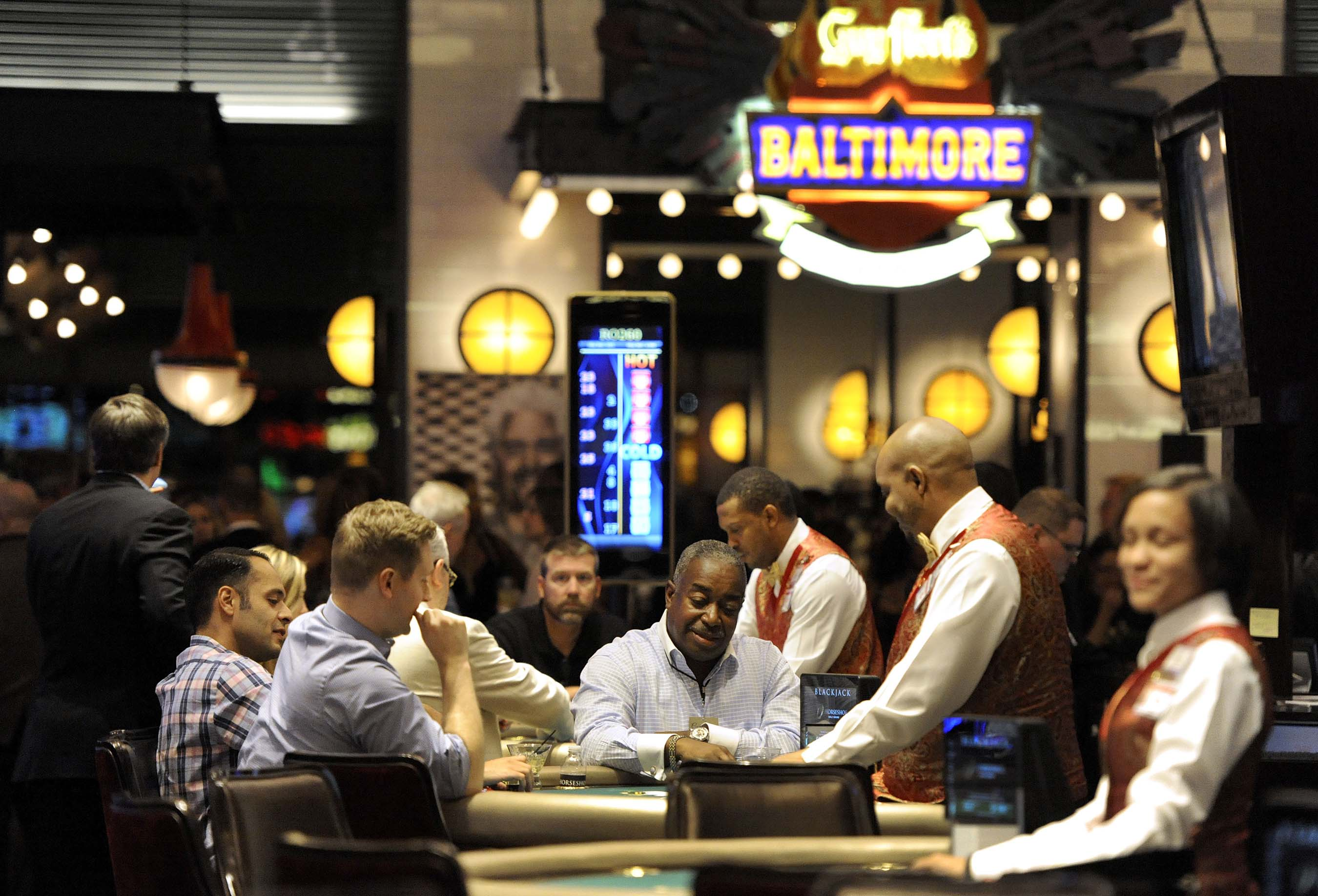 Guests test their luck at the table games during the grand opening of Horseshoe Casino Baltimore on August 26, 2014. PHOTO CREDIT: Steve Ruark