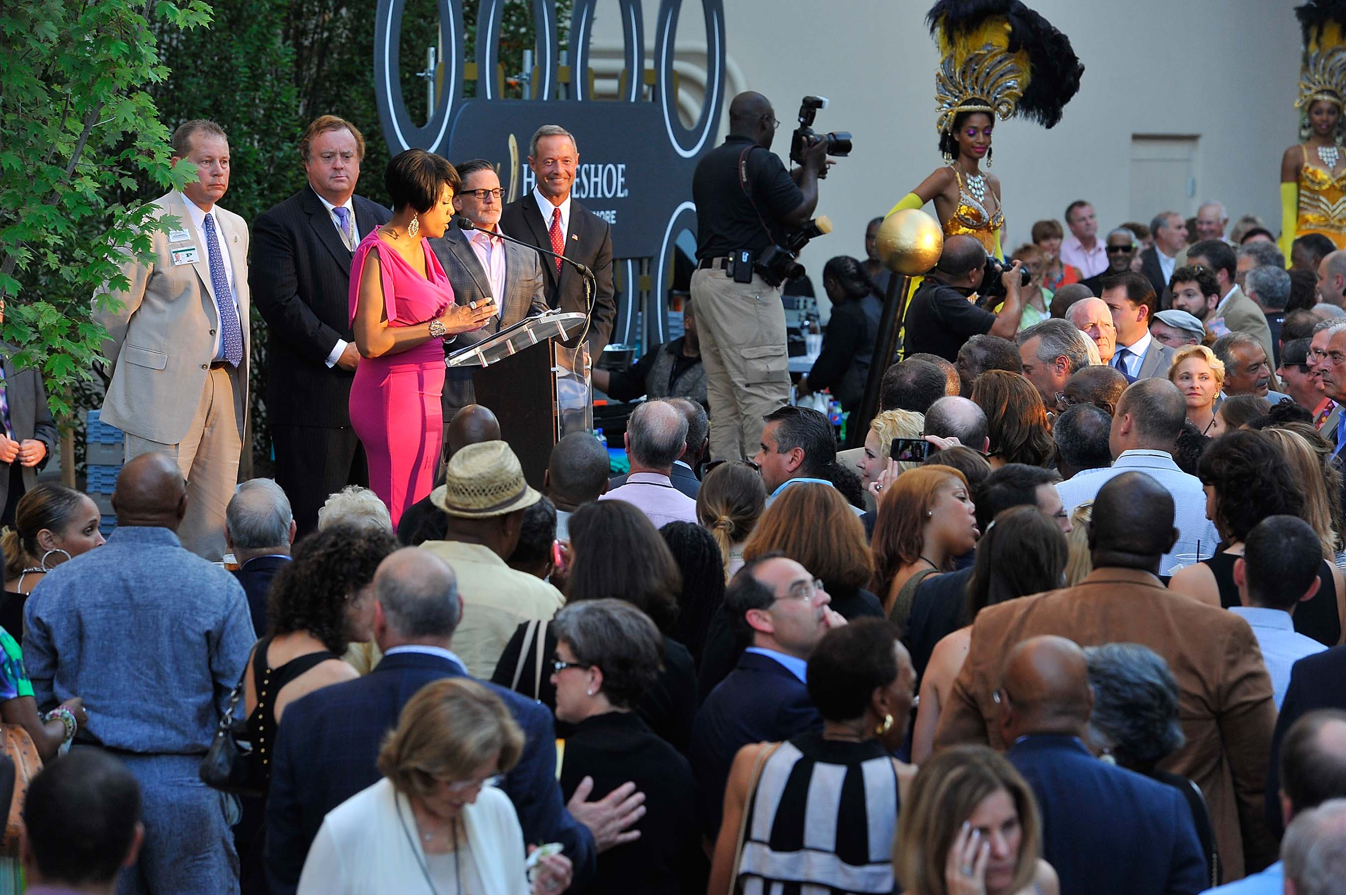 Baltimore Mayor Stephanie Rawlings-Blake address guests while Chad Barnhill, Gary Loveman, Dan Gilbert and Governor Mark O'Malley (D-MD) look on at grand opening of Horseshoe Casino Baltimore on August 26, 2014. PHOTO CREDIT: Larry French