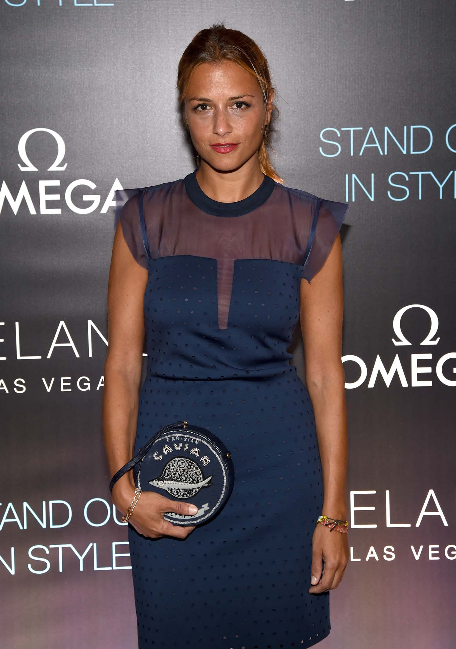 Before the grand opening of Delano Las Vegas, fashion designer Charlotte Ronson poses on the red carpet.