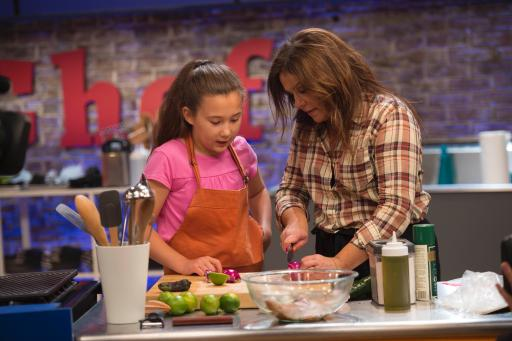 Host Rachael Ray Helps Kidtestant Scarlett on Food Network's Rachael Ray's Kids Cook-Off