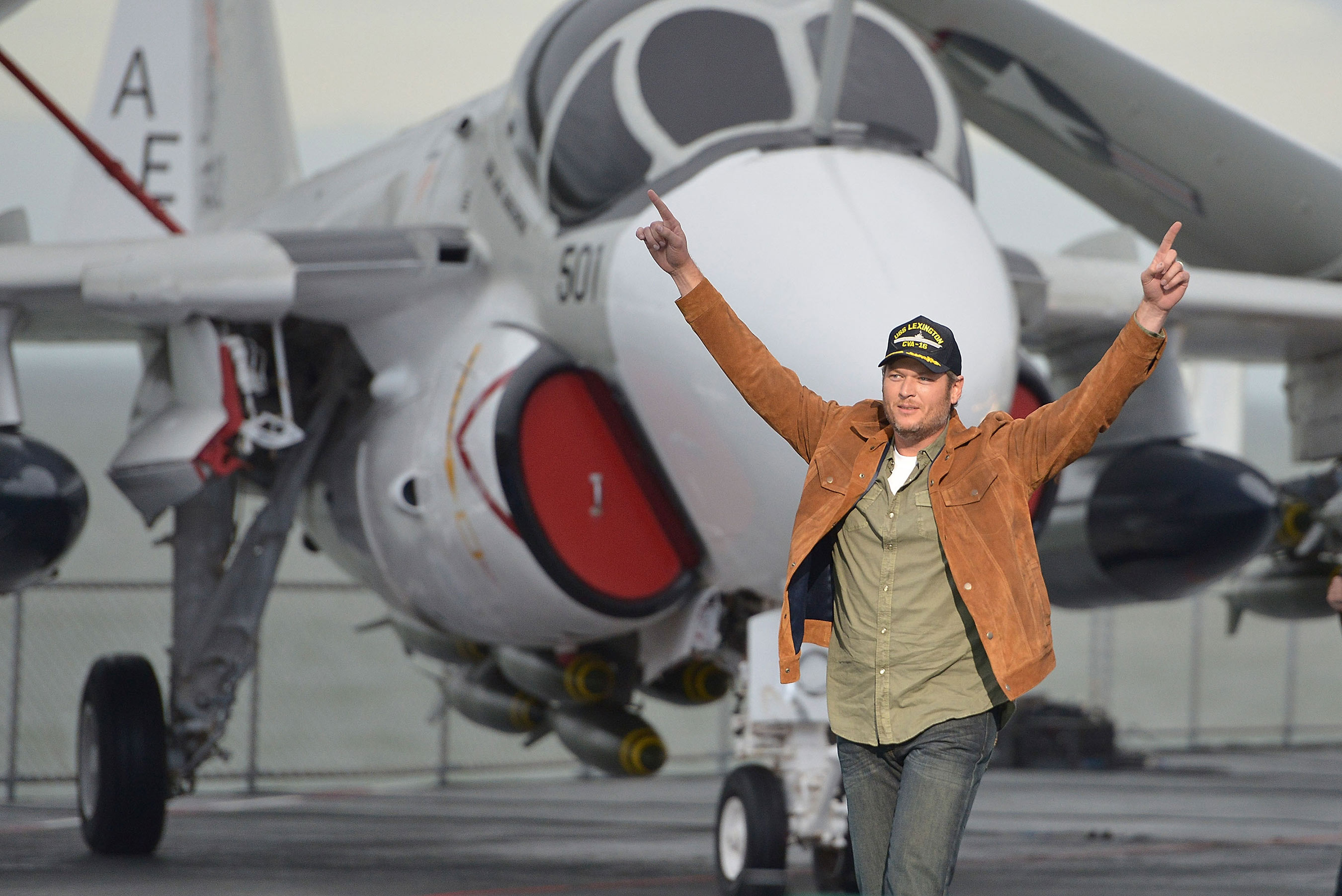 "Blake Shelton lands on the USS Lexington in Corpus Christi, TX to deliver a surprise performance to America's veterans to launch Pepsi's ""Hype Your Hometown"" campaign – a call-to-action for the chance to win a once-in-a-lifetime halftime experience."