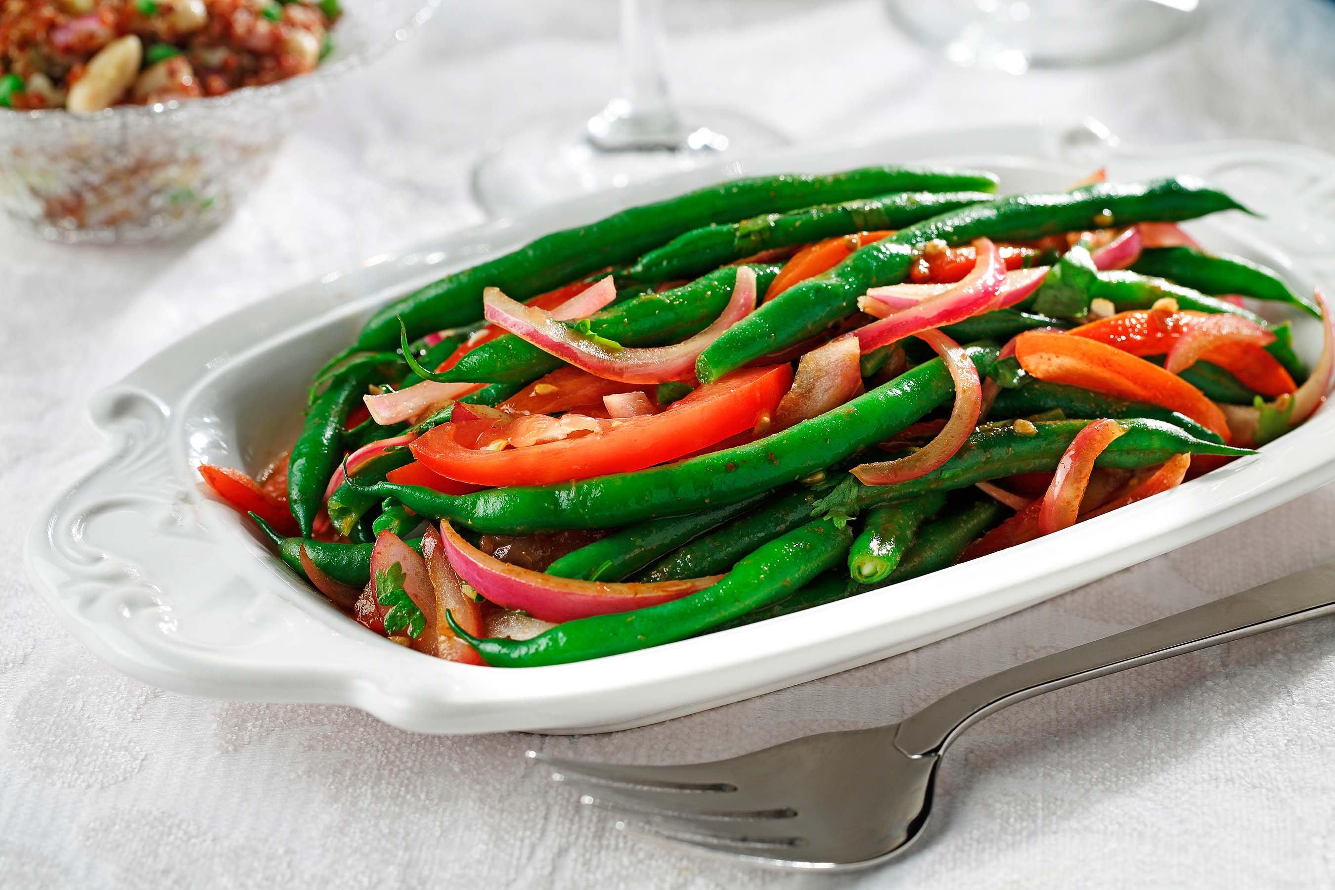 A healthy twist on the Peruvian classic lomo saltado, this recipe showcases green beans. Canola oil helps keep the dish's saturated fat content to a minimum compared to typical holiday sides.