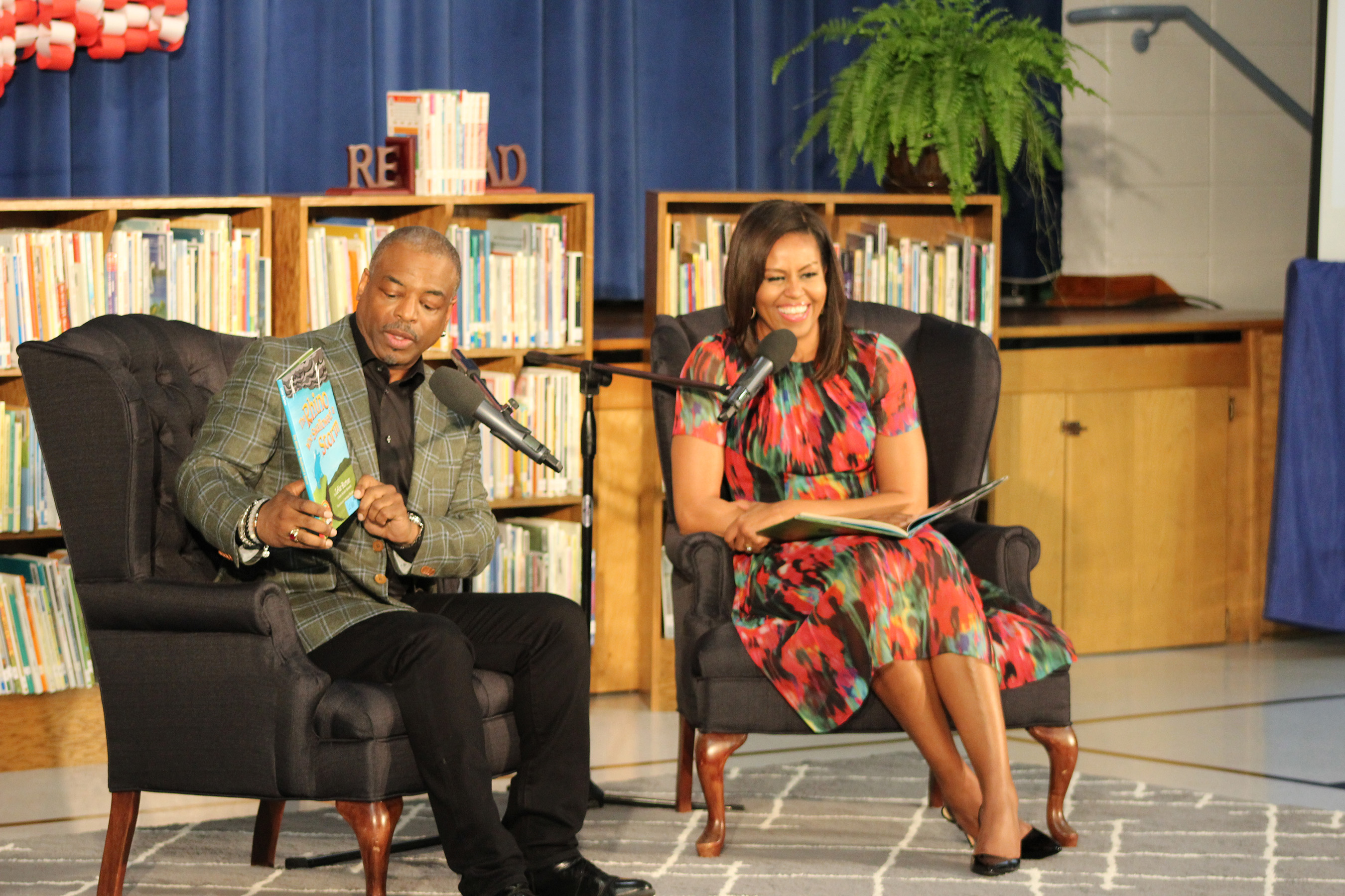 "LeVar Burton and First Lady Michelle Obama read Burton's ""The Rhino Who Swallowed a Storm"" during the Joining Forces Event at Thayer Elementary School at Fort Leonard Wood, MO. CREDIT:Jane Wolfe, RRKidz, Inc."