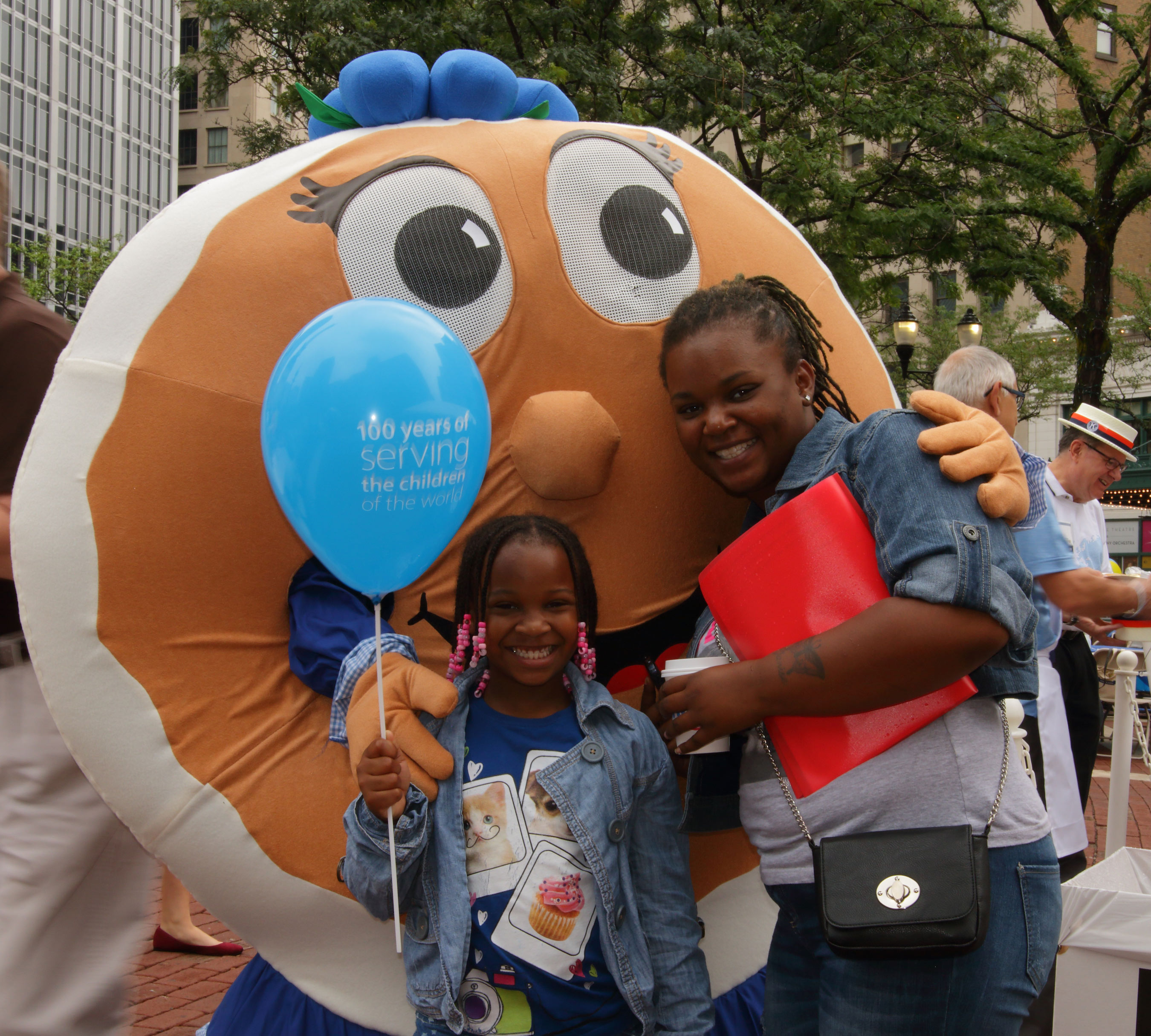 """Bonnie Blueberry welcomes guests to IHOP's """"Summer of Smiles"""" Monumental Pancake Celebration honoring Kiwanis International's 100th Anniversary"""