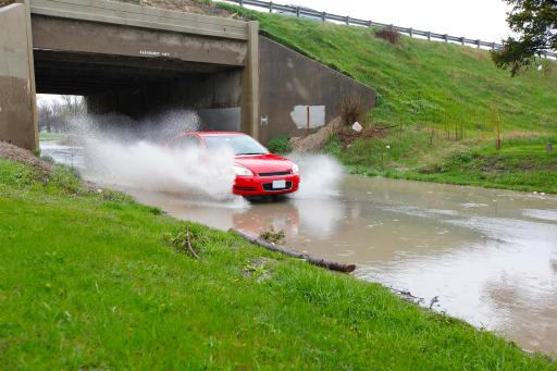 Car approaching high water with splashing
