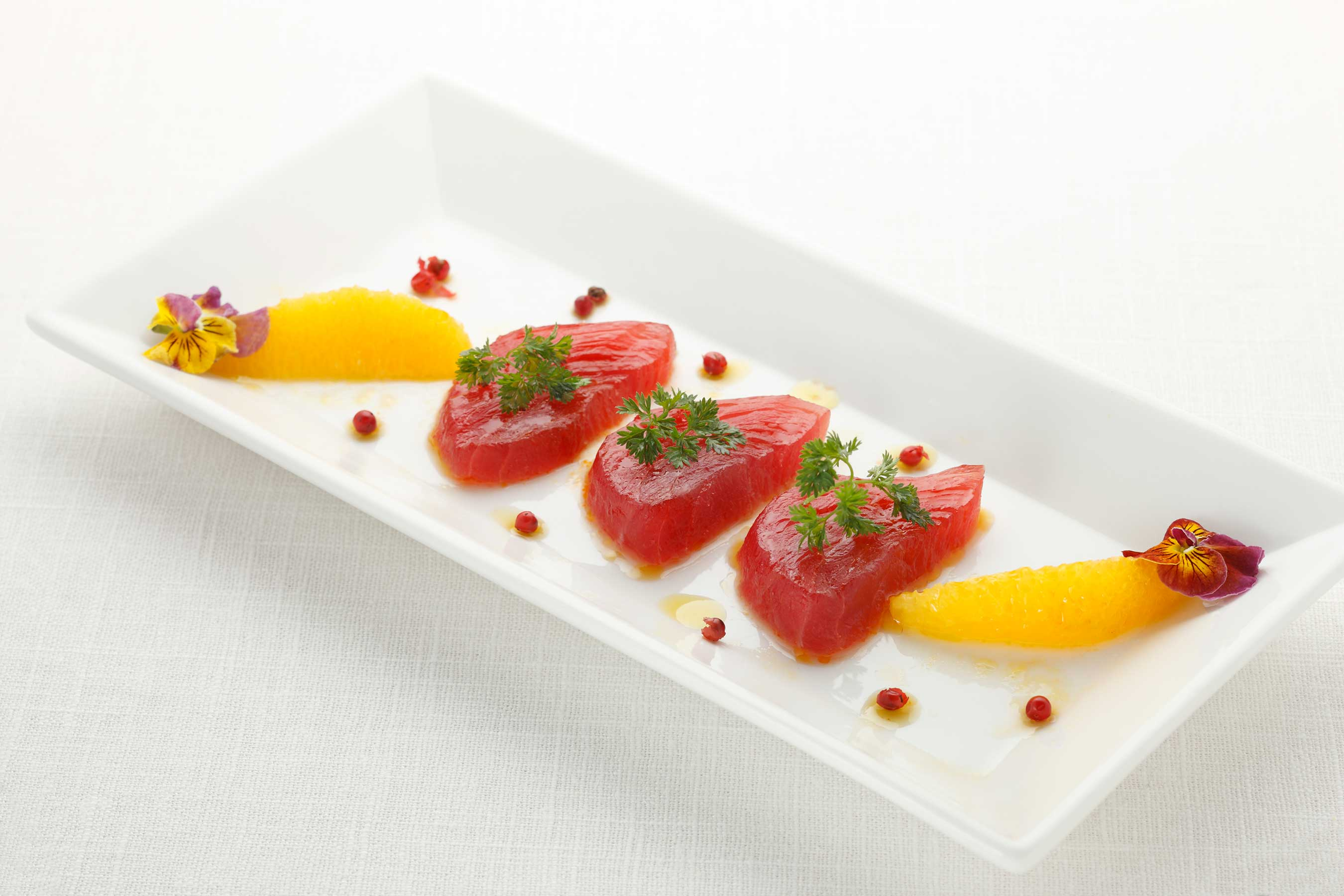 Sashimi lovers rejoice! LAGO's menu offers a drool-worthy selection of raw seafood prepared with an Italian flare like the succulent Tuna served with a seasonal citrus fruit.