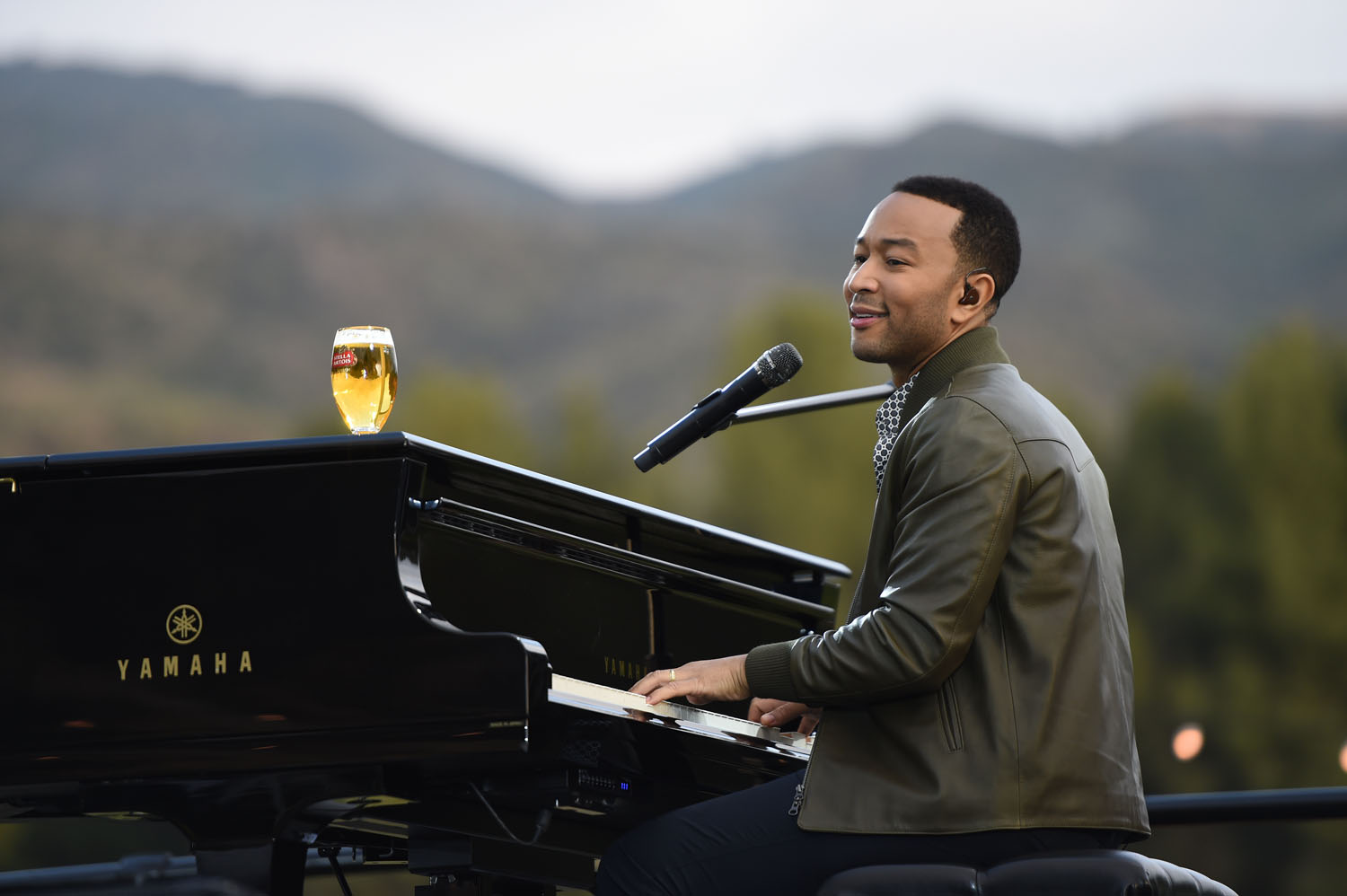 "Award-winning music artist John Legend set the mood to launch Stella Artois ""Host Beautifully"" with an intimate, musical performance. Photo credit: Michael Buckner/Getty Images"