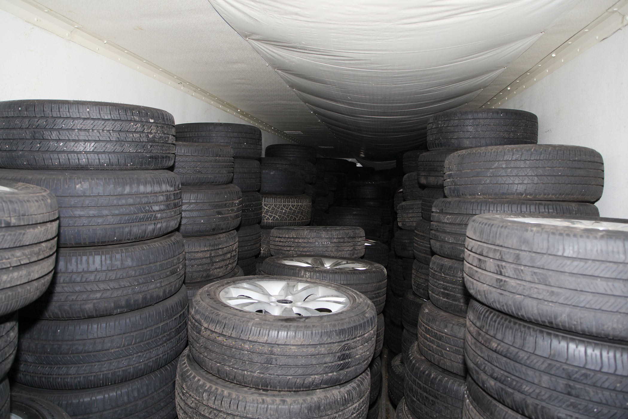 Some of the 240 tires and rims recovered by law enforcement following a lengthy theft investigation.