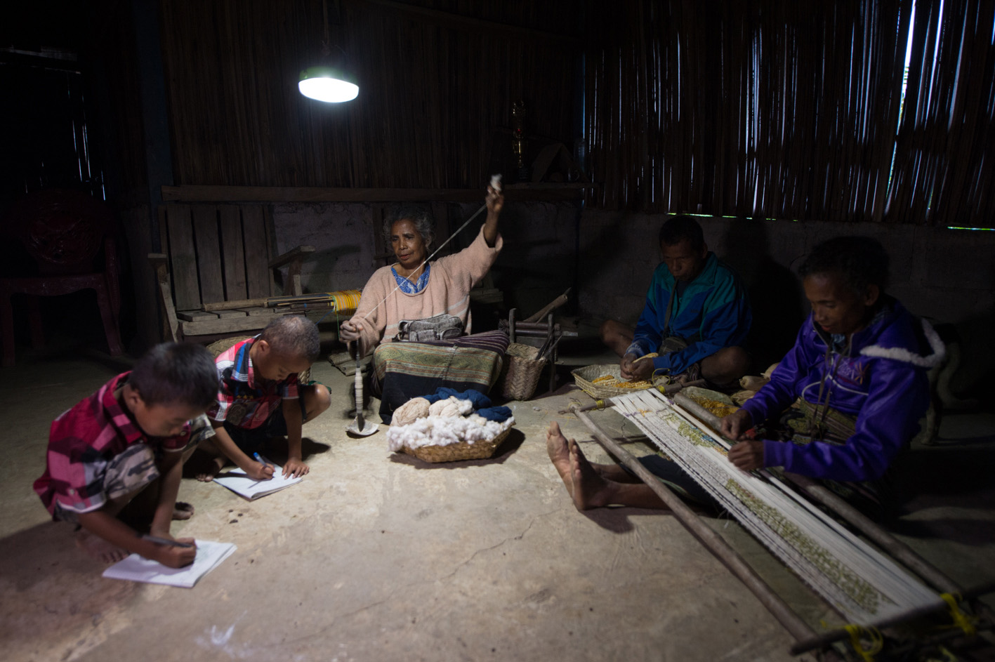 Working by the light of a solar lantern.