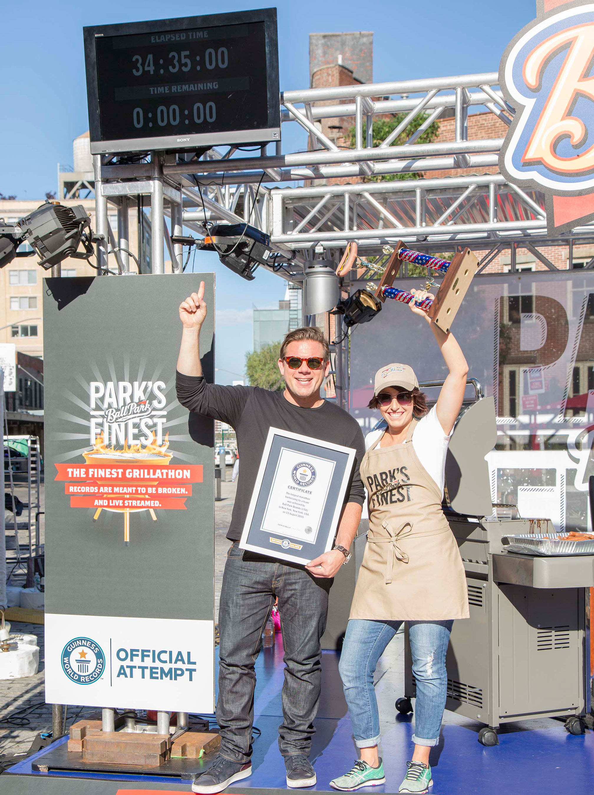Tyler Florence celebrates victory after 34+ hour grillathon with Ball Park Park's Finest™ franks
